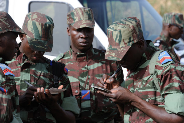 Burkinabe soldiers complete necessary passport and visa documentation prior to their deployment to Mali in support of exercise Flintlock 10 in Ouagadougou, Burkino Faso, May 1, 2010.