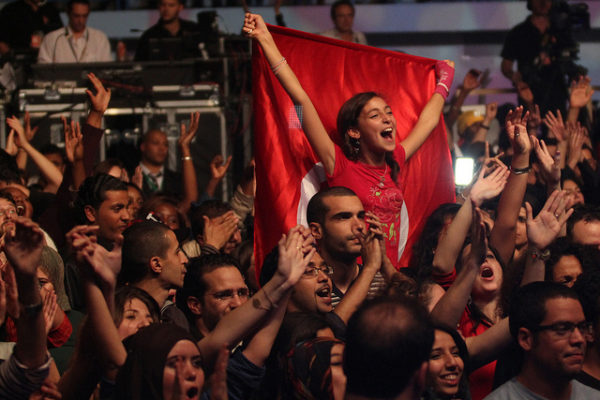 A girl in the crowd waves the Tunisian flag at the 'Africa Celebrates Democracy' concert. Photo: Mo Ibrahim Foundation