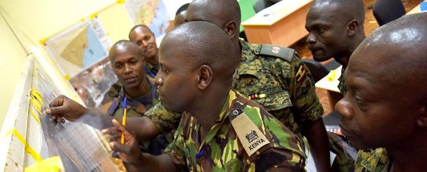 Officers from Kenya, Burundi and Uganda plan military operations for a simulated scenario