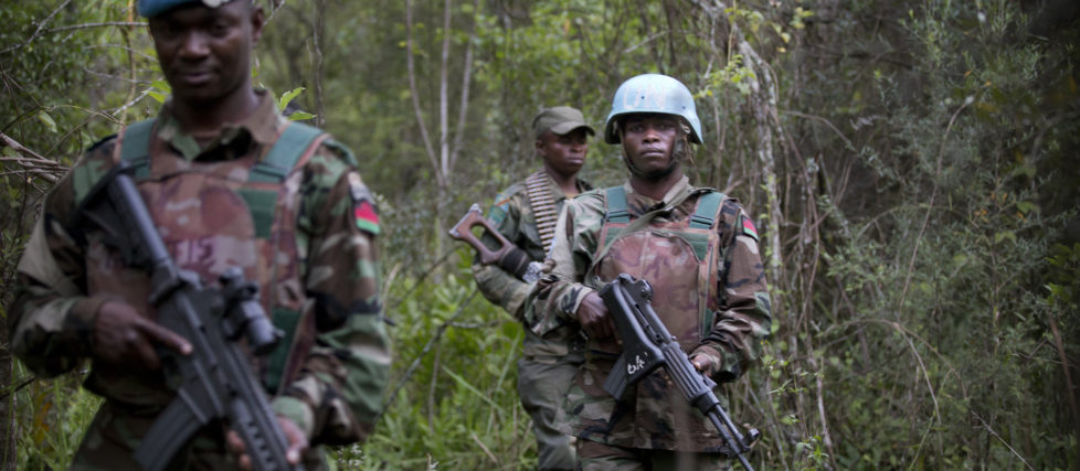 Elements of FIB Malawi contingent patrol with DRC Governmental Forces during joint operations against FDLR near Tongo, the 19th of March 2014. © MONUSCO/Sylvain Liechti