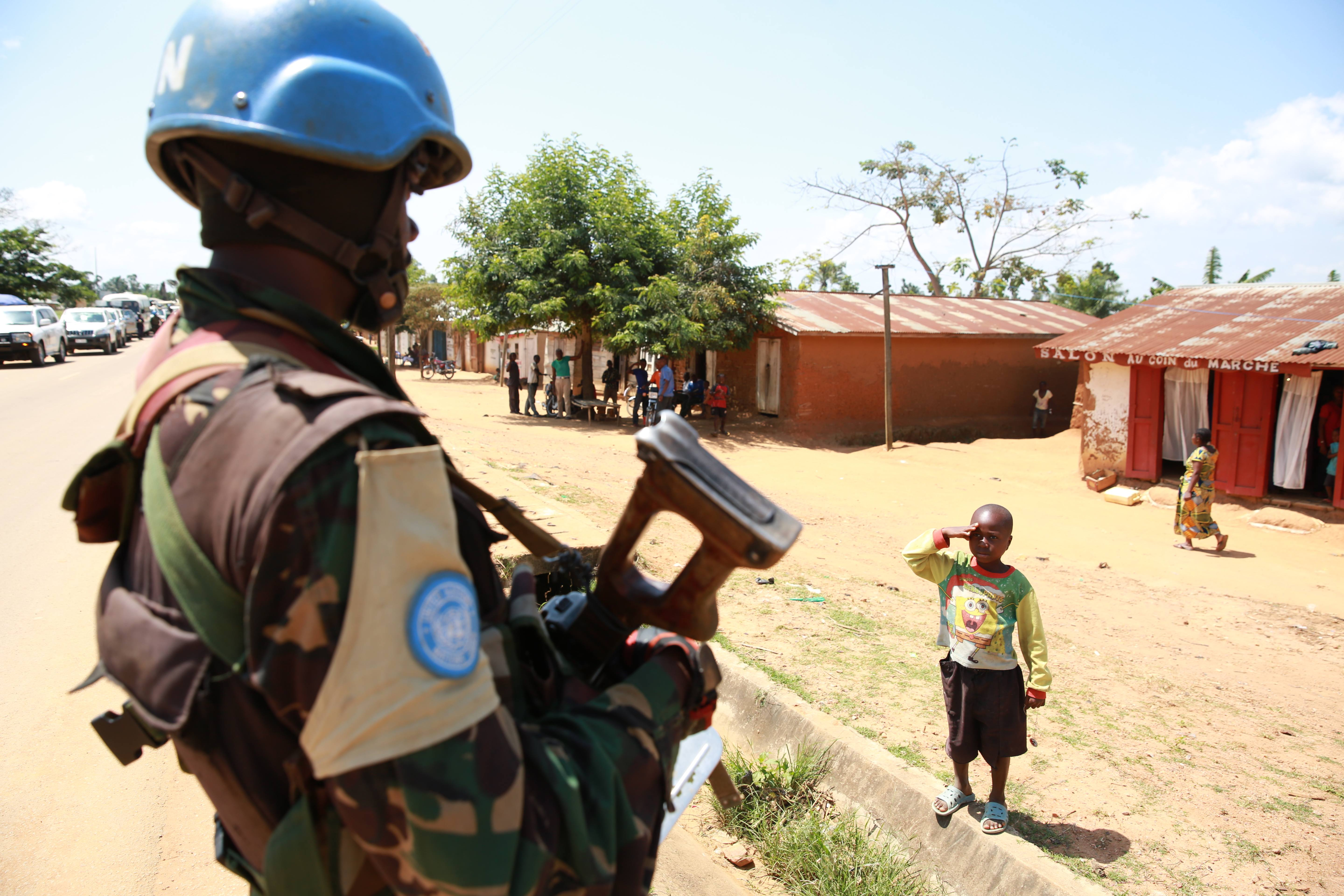 A_child_saluting_and_thanking_a_MONUSCO_peacekeeper