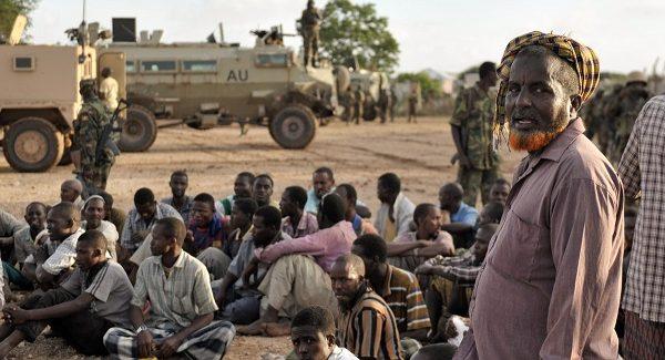Somali men gather in Kurtunwaarey-AMISOM Photo / Tobin Jones