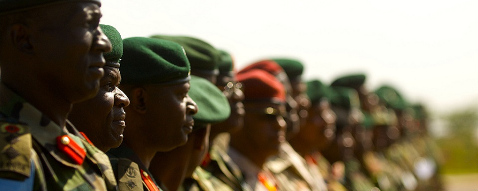 Officers with the East African Standby Brigade stand ready to salute the flags of 13 East African Nations represented at the first ever EASBRIG Command Post Exercise in Nairobi, Kenya. The East African Standby Brigade brings together 13 eastern African nations under the umbrella of the African Union.