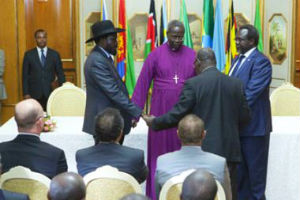 Salva Kiir and Riek Machar with two clergy members. Photo: AFP/Zacharias Abubeker
