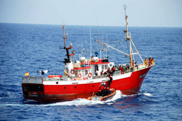 US and Cape Verde coast guard and judiciary police embark a fishing boat