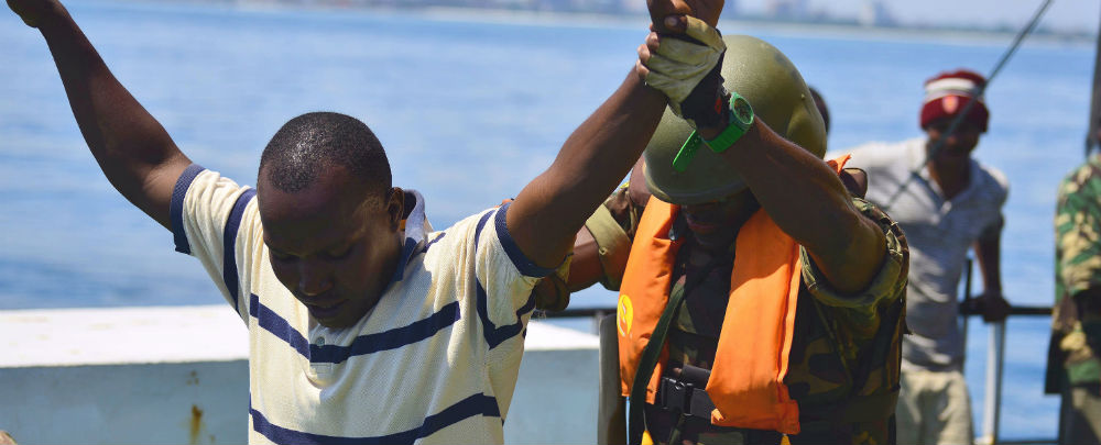 An Armed Forces for the Defence of Mozambique boarding team member searches a simulated illegal fisherman during Exercise Cutlass Express 2013.