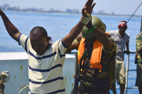 An Armed Forces for the Defence of Mozambique boarding team member searches a simulated illegal fisherman during Exercise Cutlass Express 2013. (Photo: US Air Force/Tech. Sgt. Chad Thompson.)