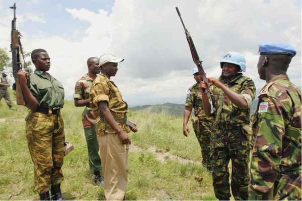 February 2005; Members of the CNDD-FDD rebel forces surrender their weapons to United Nations Operation in Burundi (ONUB) peacekeepers in Mbanda, southern Burundi. (UN Photo/Martine Perret)