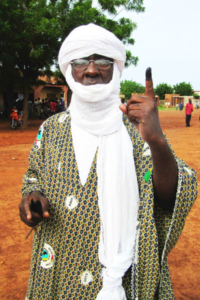 A voter in Mali shows off his inked finger in 2013.