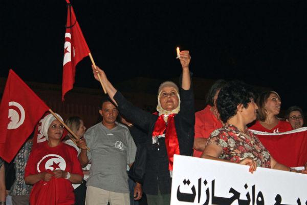 Tunisian protesters denounce terrorism.