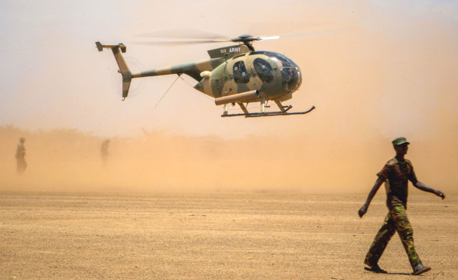 A Kenyan Air force helicopter landing in southern Somalia