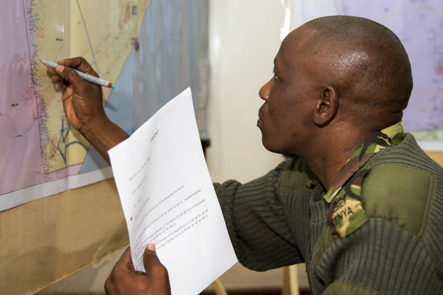 A Kenyan soldier plotting troop movements on a map during an Africa Contingency Operations Traning and Assistance (ACOTA) training course.