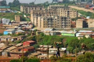 Kibera slum with condos in the background
