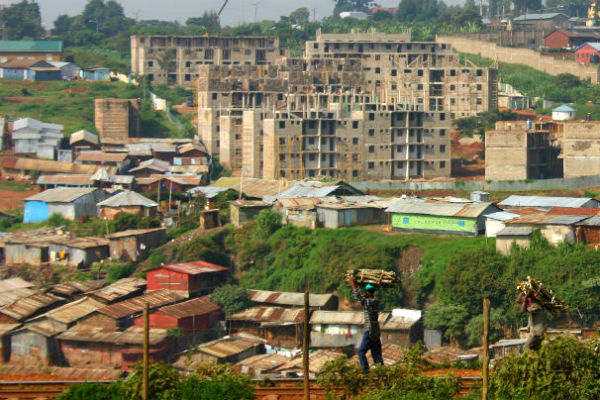 Kibera slum with condos in the background