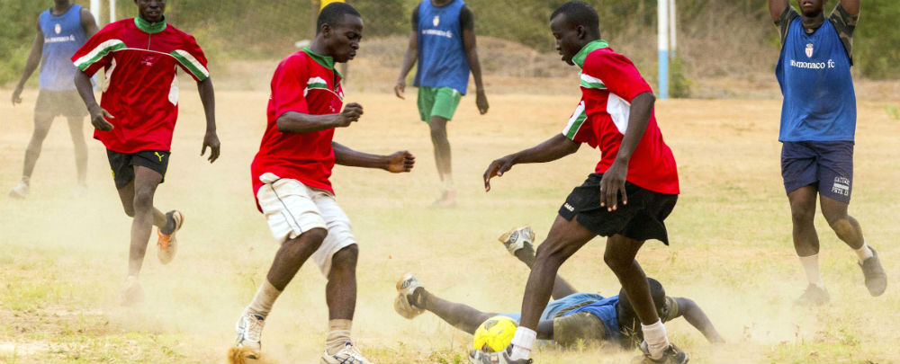 Senegal and Burkina Faso soldiers play soccer