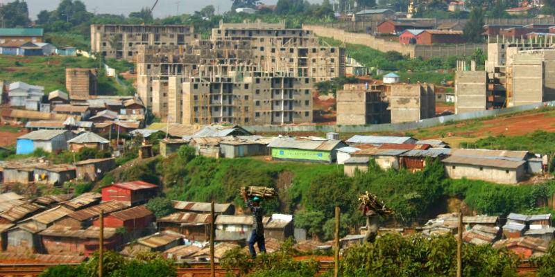 Kibera slum in Nairobi, Kenya, with condos under construction in the background.