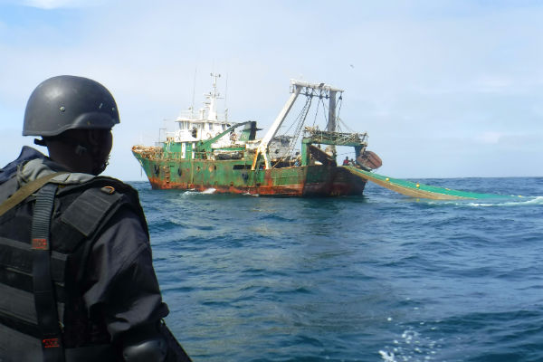 Senegalese navy personnel board a fishing vessel 600x400