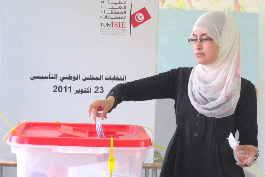 A woman casting a ballot in the 2011 Constituent Assembly election