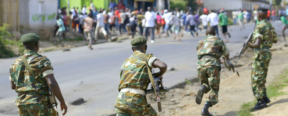Burundi soldiers chase protesters 1000x405