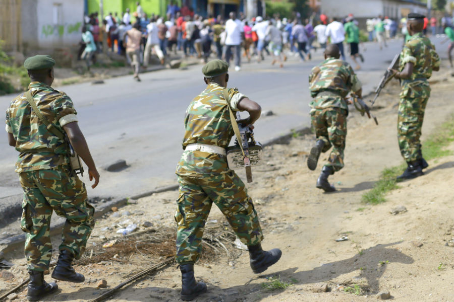 Burundian soldiers dispersing protesters in Bujumbura