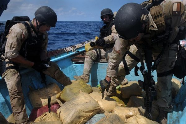 U.S. Coast Guard Maritime Safety and Security Team disposes of illegal narcotics off the coast of Somalia.