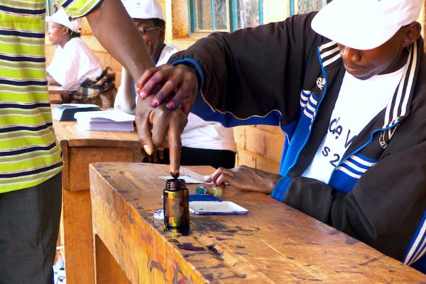 A man votes in the 2010 Burundi election