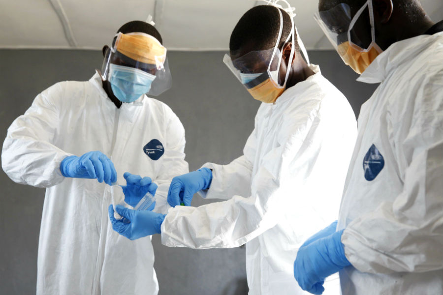Researchers take a sample swab at C.H. Rennie Hospital in Kakata, Liberia.