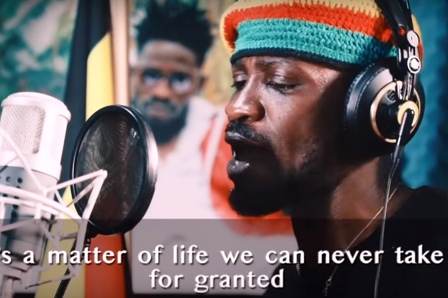 Bobi Wine recording a song to sensitize listeners to the threat of COVID-19.