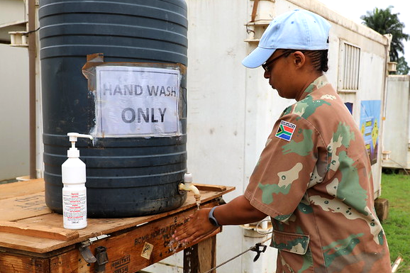 A member of MONUSCO practicing measures to avoid the spread of COVID-19.