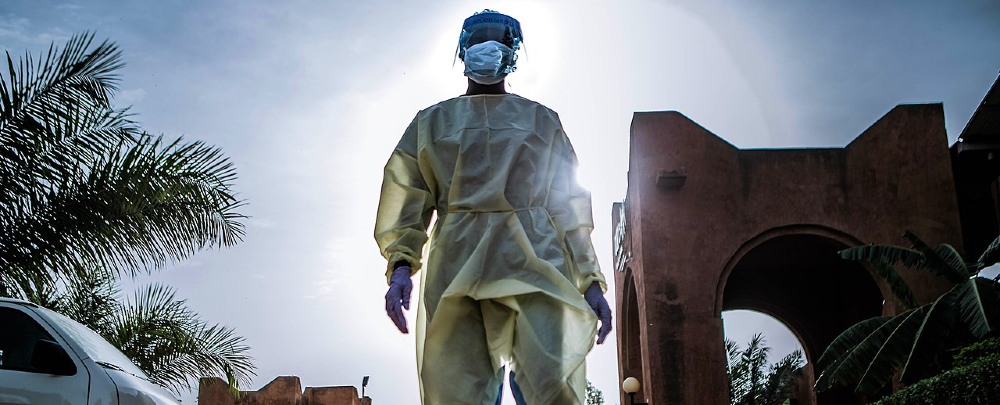 A nurse in Niger returning from her shift screening patients