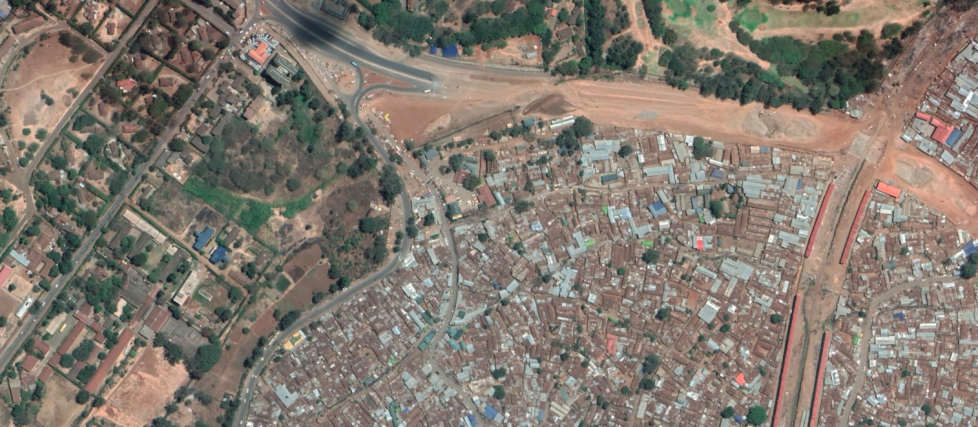 Kibera, Nairobi bordering upscale developments and a golf course.