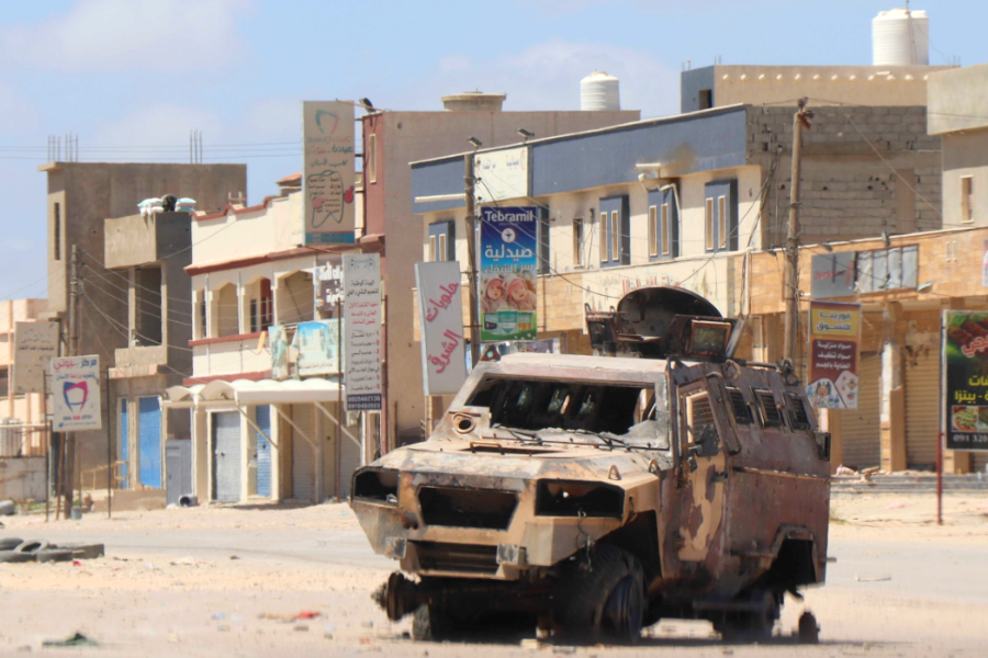 A burnt-out vehicle is left behind after a battle in Tripoli, April 2019