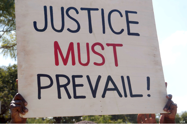 A placard held by a protester during a post-election demonstration in Lilongwe.