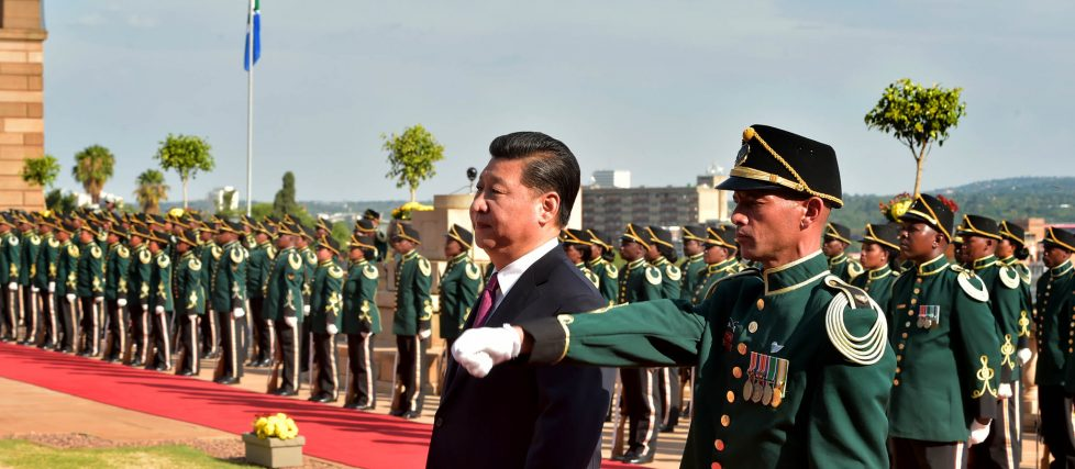 Chinese President Xi Jinping inspects the South African military guard of honour.