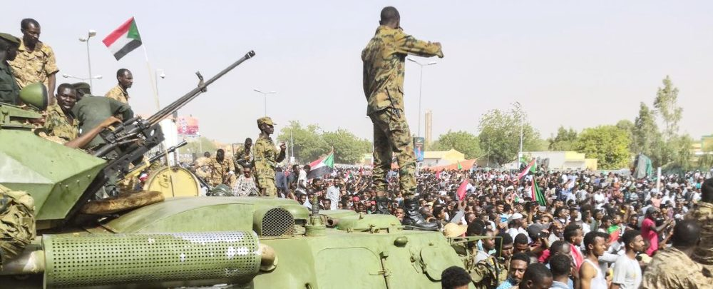 Sudanese soldiers during an anti-Bashir protest in April 2019.