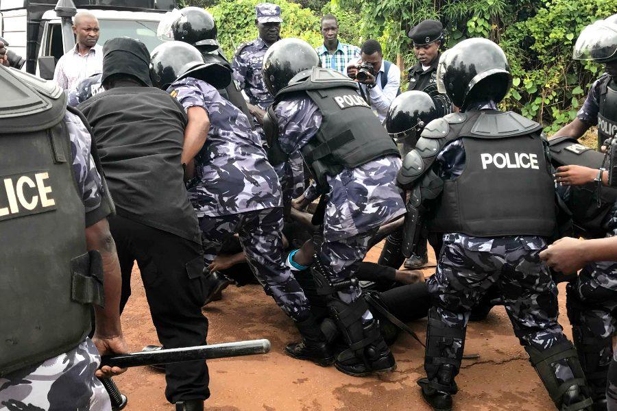 Uganda police arresting a protester