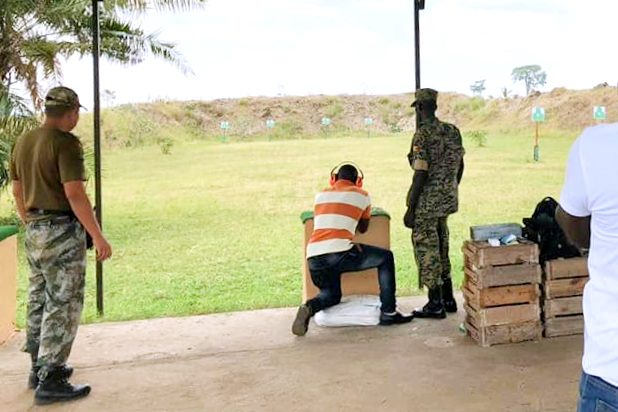 Ugandan military personnel being trained by a former member of the PLA.