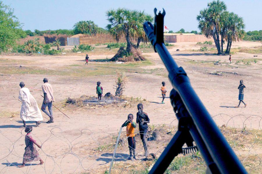 South Sudan civilians under a rifle